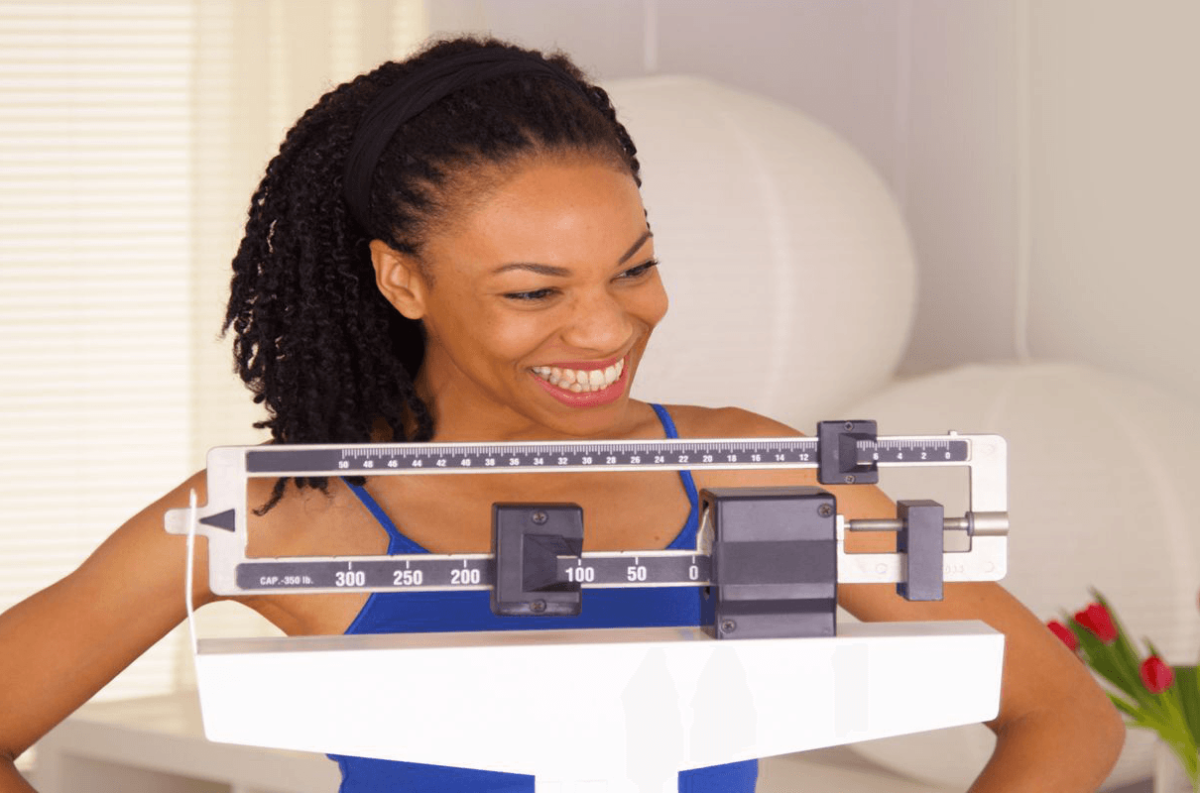 woman-on-scale-happy-4x3